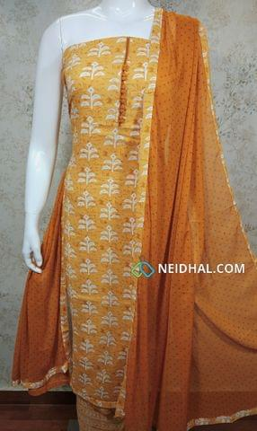 Printed Fenu Greek yellow Rayon Unstitched salwar material(requires lining) with potli buttons on yoke, Printed Fenu greek yellow cotton bottom, Printed fenu greek yellow chiffon dupatta with tapings,