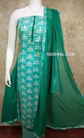 Printed Turquoise Blue Rayon Unstitched salwar material(requires lining) with potli buttons on yoke, Printed turquoise blue cotton bottom, Printed green chiffon dupatta with tapings,