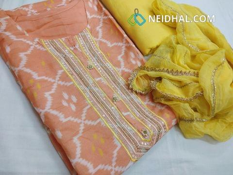 Designer Peach Masleen silk  unstitched salwar material(requires lining) with neck patten, zari thread work on yoke, plain back side, yellow drum dyed cotton bottom, sequence work on pure  chiffon dupatta with fancy tapings.