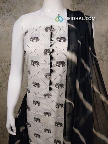 Printed White Cotton unstitched salwar material(requires lining) with yoke patten and foil mirror work,  black cotton bottom, printed black chiffon dupatta.(requires taping)