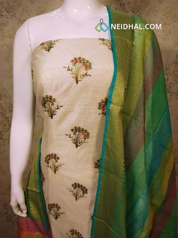 Cream Silk Cotton unstitched Salwar material(requires lining) with embroidery work on front side, Plain back side, green silk cotton bottom, silk cotton dupatta with tassels.