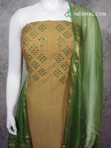 MEhandhi Yellow Silk Cotton unstitched salwar material with foil mirror work on yoke, green cotton bottom, green silk cottot dupatta with tassels