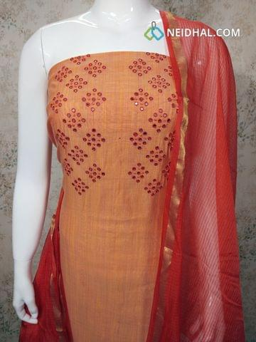 Orange Silk Cotton unstitched salwar material with foil mirror work on yoke, red cotton bottom, red silk cottot dupatta with tassels