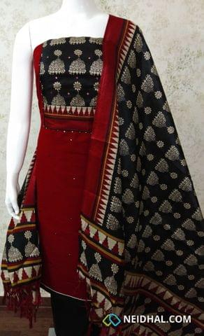 Red Slub Cotton unstitched salwar material with printed art silk yoke, and foil mirror work on front side, plain back side, black silk cotton bottom, Printed art silk dupatta with tassels.