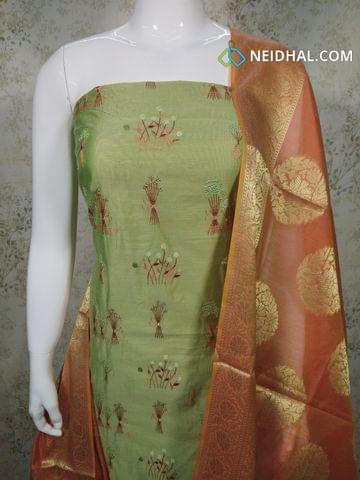 Designer Green Silk Cotton unstitched salwar material with embroidery work on front side, plain back side, dark peach silk cotton bottom, Benaras weaving silk cotton dupatta with tassels.