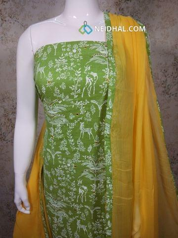 Printed Green Slub Cotton unstitched salwar material with foil mirror work on front side, yellow cotton bottom, yellow chiffon dupatta with tapings.