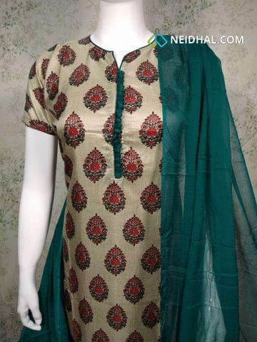 Premium Floral printed Semi Tussar Unstitched salwar material(requires lining) with neck patten, potli buttons on yoke, green silk cotton bottom, green chiffon dupatta with tapings.
