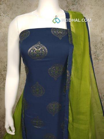 Printed Navy Blue Rayon unstitched salwar material with golden prints, green Cotton bottom, green chiffon dupatta with taping