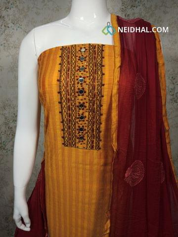 Yellow Silk Cotton unstitched Salwar material with foil mirror, french knot, bead work on yoke, plain back side, maroon cotton bottom, embroidery work on maroon chiffon dupatta with tapings.
