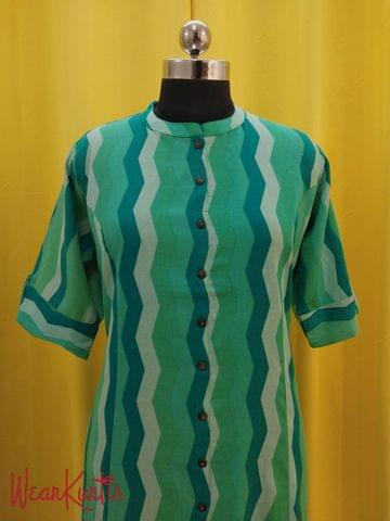 Printed Green Jute Flex Kurti with front placket(2 buttons can be unbuttoned)(Refer Size chart, 3rd pic before ordering, No Refund, No Return, No exchange, No cancellation), Mandarin Collar, Height 43-44, 3/4 Sleeves with flaps, Princess Cut, front and side slit, one side pocket.