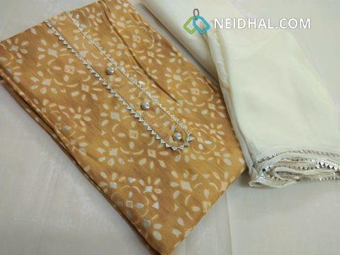 Dark Beige Printed Liquid fabric (flowy fabric) unstitched salwar material, cream cotton bottom, cream chiffon dupatta with taping