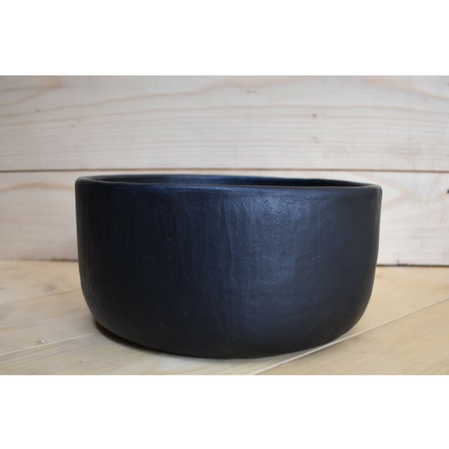 Bowl with curved base