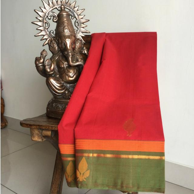 Chettinad Red and Green Cotton Saree With Complimenting Zari & Thread Floral Motifs On The Border