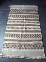 "Brown Kharad ""Rug"" with various motifs"