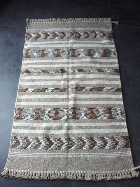 "Brown Kharad ""Dhurrie"" with various motifs"