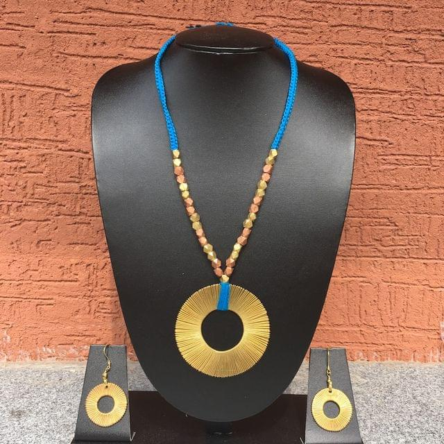Brass Necklace With Chakra Pendant In Blue Thread With Earrings