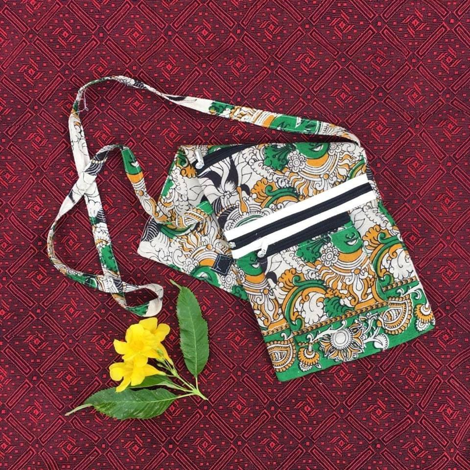 Aarika Green Cotton Handy Sling Bag with Face Pattern