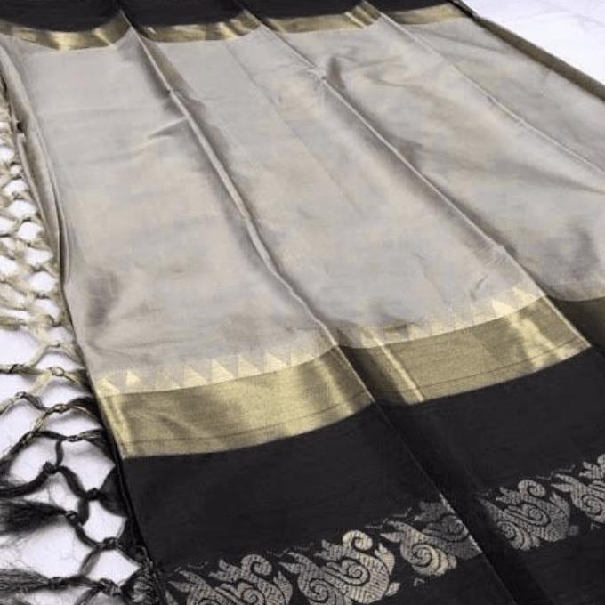 Aarika Cream Silk Cotton Saree with Black Border
