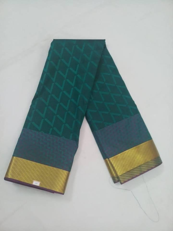 Pink Pearls Soft Semi-Dark Green Saree With Contrast Blouse.