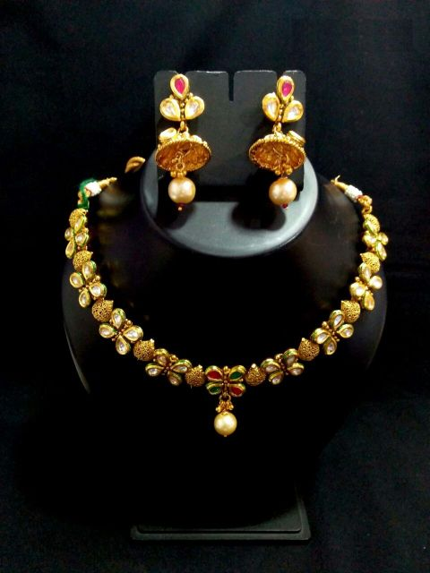Gold plated Necklace set studded with stones- with an year warranty