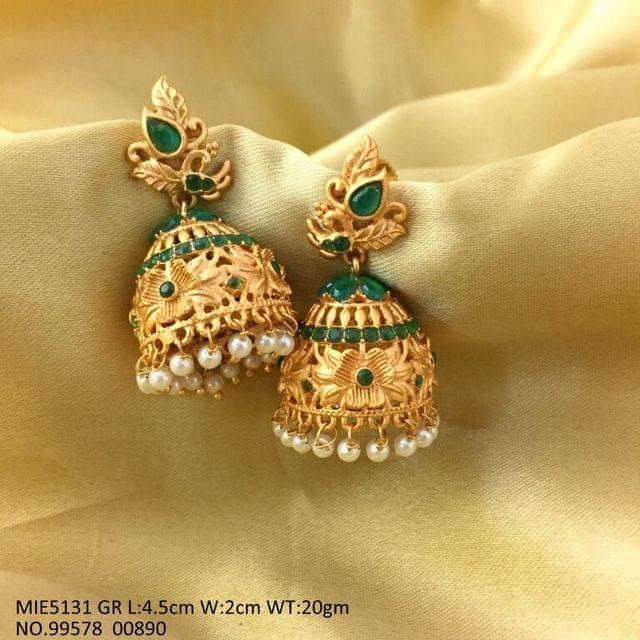 Gold plated earrings with an year warranty