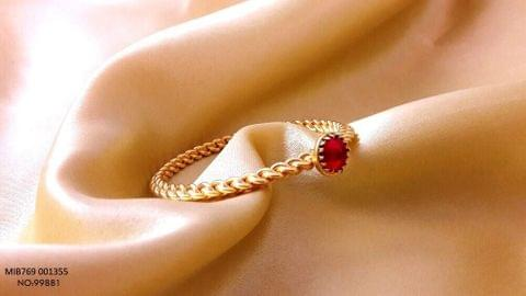 Gold plated kad with precious stone