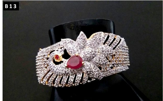 Beautiful american diamond +semi precious ruby stone studded kada with an year warranty
