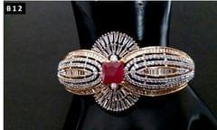 Beautiful american diamond +semi precious ruby stone studded kada with an year warranty
