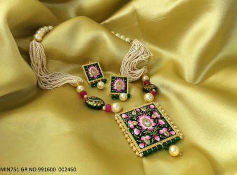Buy this beautiful necklace made of Brass, with sound Meenakari work and semi precious beads and pearls