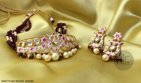 Handprinted ,Studded with Kundan Stones and pearls with semi precious beads