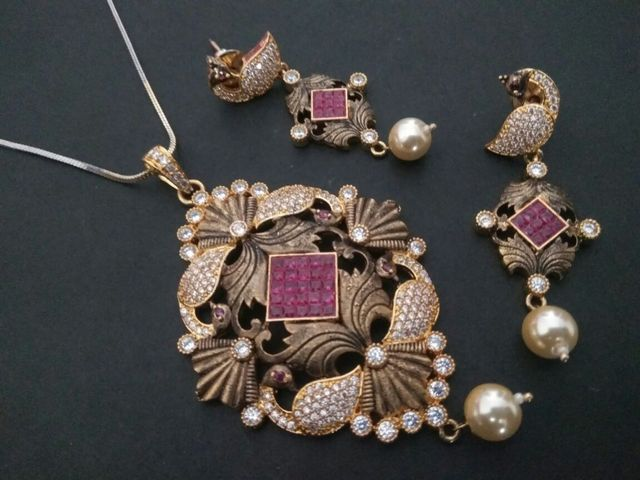 Brass + Gold Plated + Ad Stones Studded+ Ruby Stones Pendant Set
