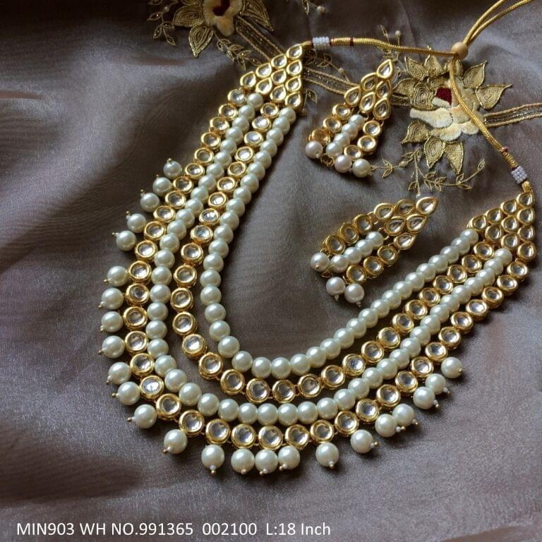 Beautiful Kundan+ Pearl necklace + Beads with an year warranty