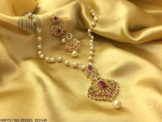American Diamod Pendant set with fresh water pearl chain and beautiful pair of earrings- 1 year warranty