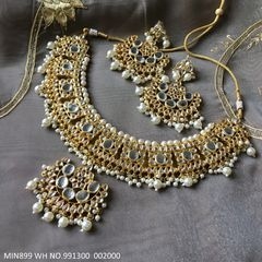 High class Kundan Necklace studded with semi precious stones . It is coupled with pair of beautiful jhumki.