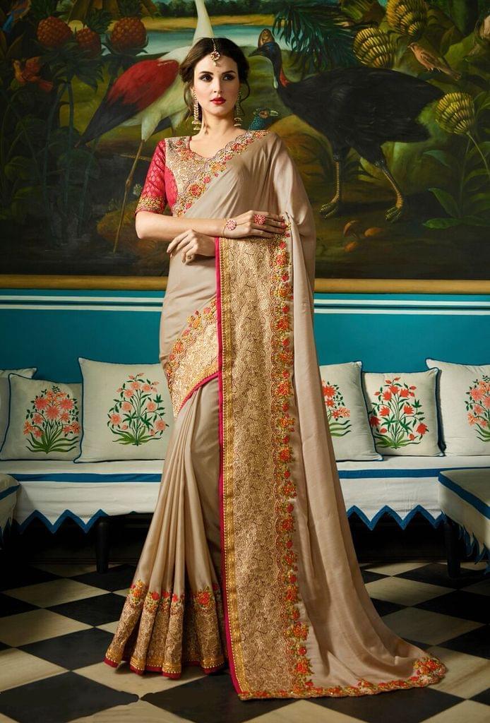 Soft Silk saree with Jacquard Silk & Art Silk blouse and Jari & Resham Embroidery With Stone Work