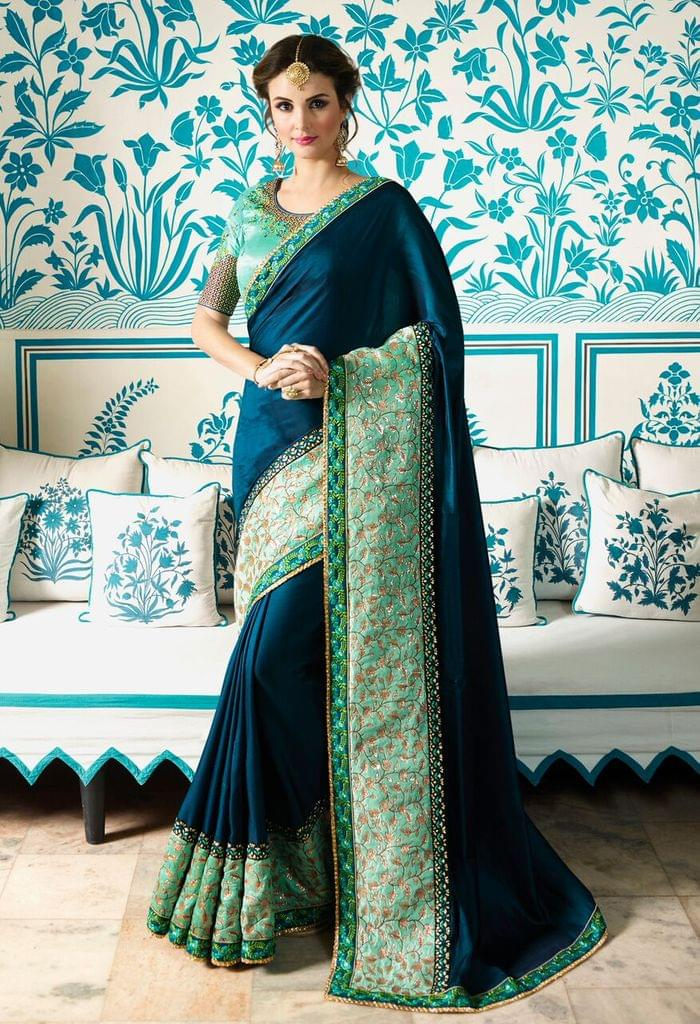 Soft Silk saree with Art Silk blouse and Jari & Resham Embroidery With Stone Work