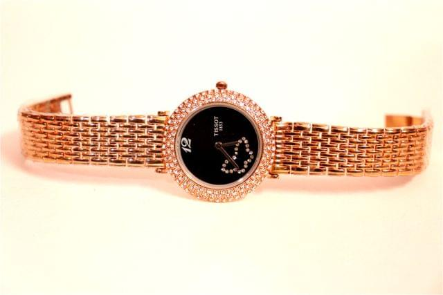 Beautiful watch with butterfly figure engraved in dial.1 year warranty