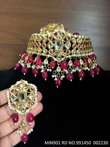 Buy high class Minakari Worked Kundan Necklace studded with semi precious stones.It is coupled with pair of beautiful jhumki.