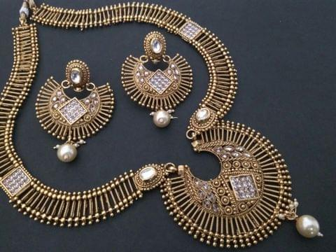Gold Plated Necklace set with an year warranty- Studded with American Diamond