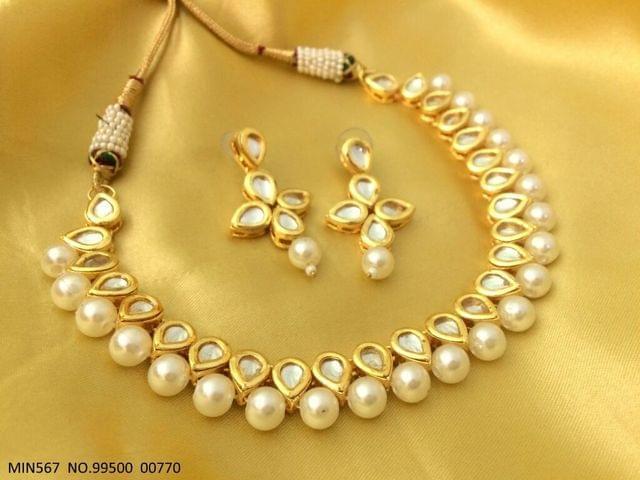 Kundan Necklace set with pair of Kundan Jhumkas with an year warranty