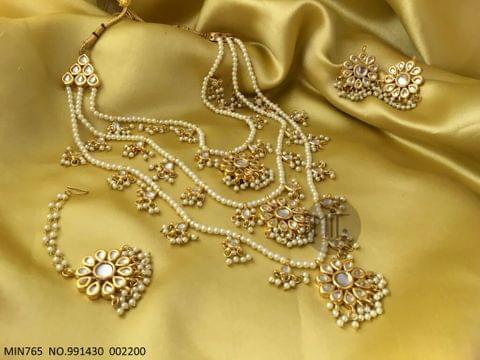 Kundan Necklace + Pair of Jhumka + Mangtika with an year warranty