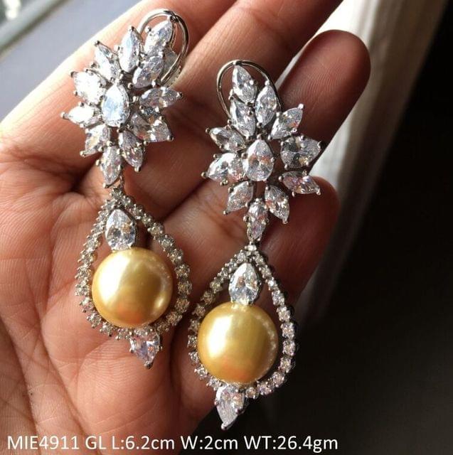 Brass+ American Diamond + Pearl Dangler with an year warranty