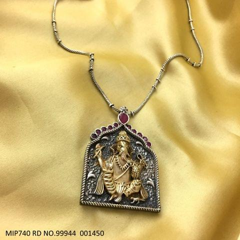 Gold Plated Ganpati Pendant set studded with semi precious stone. Base metal is German Silver