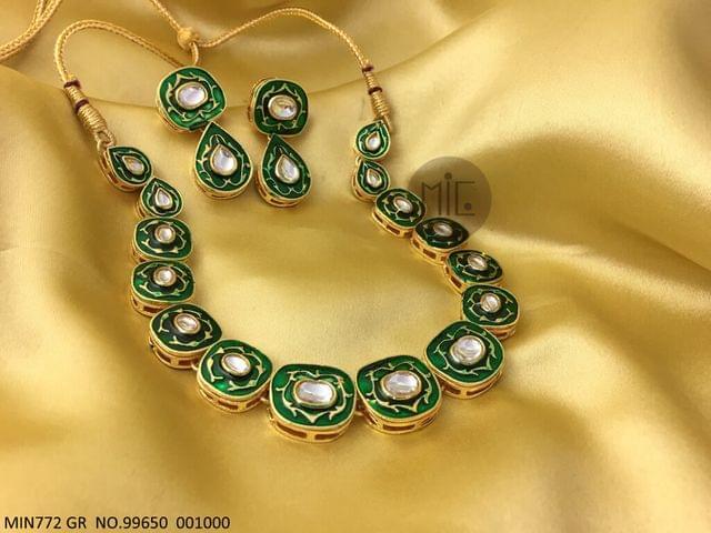 Kundan Studded Necklace with hand-art and Kundan Stones