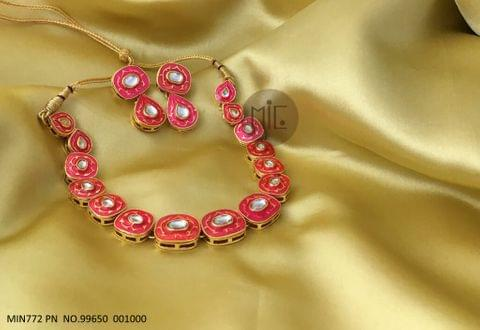 Kundan Studded Necklace with hand-art and Kundan Stones