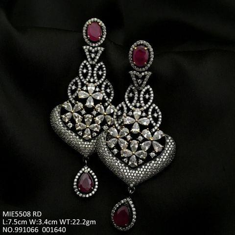 Buy this beautiful pair of danglers made of American Diamond with base of Brass