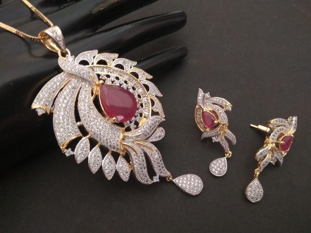 Buy this beautiful pair American Diamond Pendant Set with beautiful Pair of Earrings