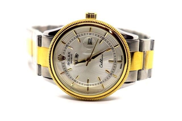 Buy this beautiful watch , with 1 year warranty. It a mens watch- It has 1 year warranty