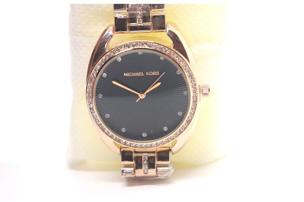 Beautiful watch with black dial and art diamonds studded