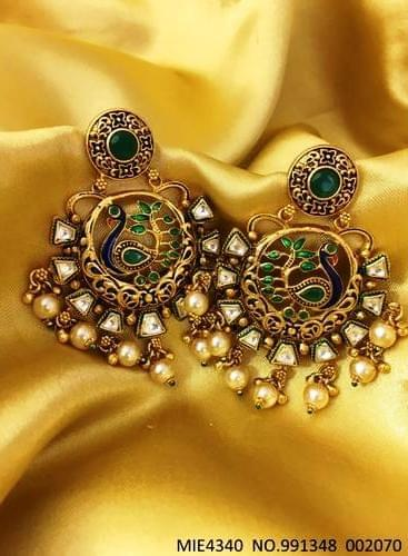 Buy this beautiful hand-printed Dangler with an year warranty. It is studded with semi precious stone,Kundan Stones